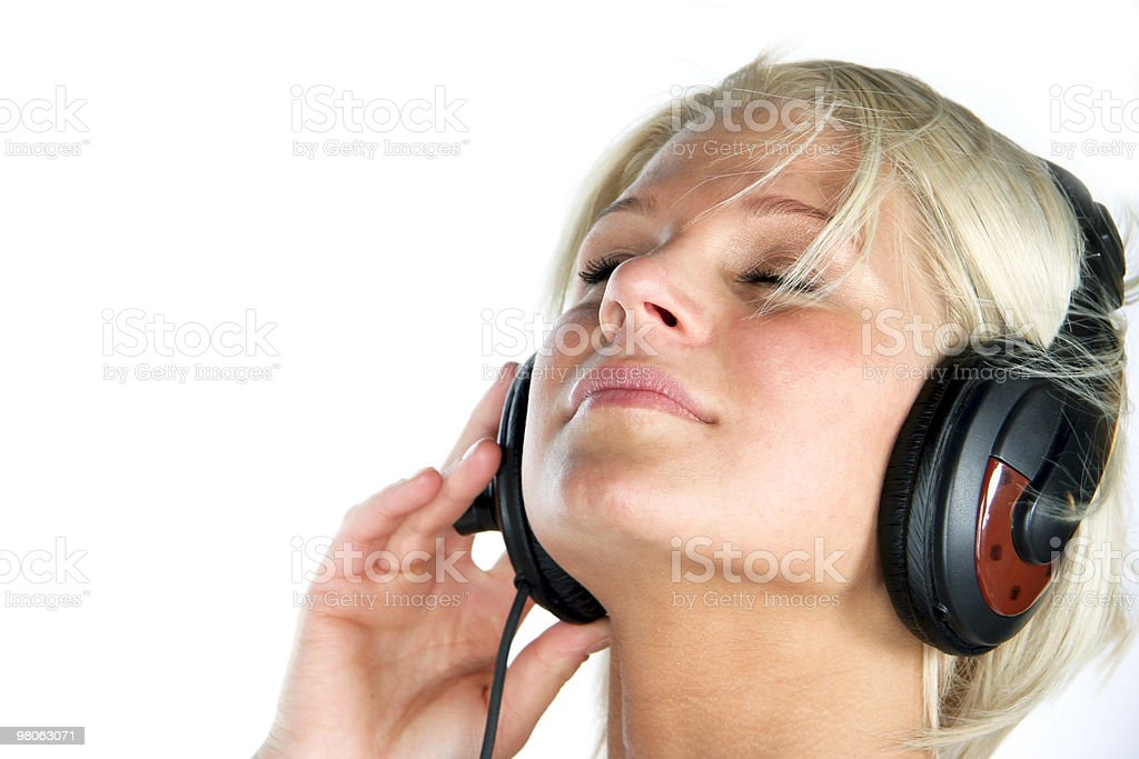 Young woman listening music royalty-free stock photo