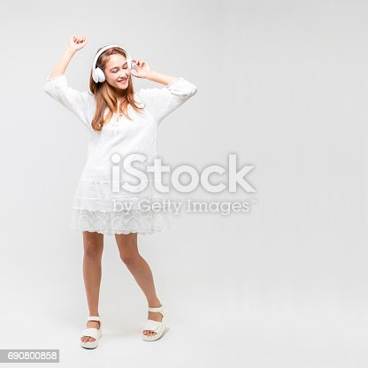 young woman listening music with wireless headphone, half latina and half asianyoung woman listening music with wireless headphone, half latina and half asian