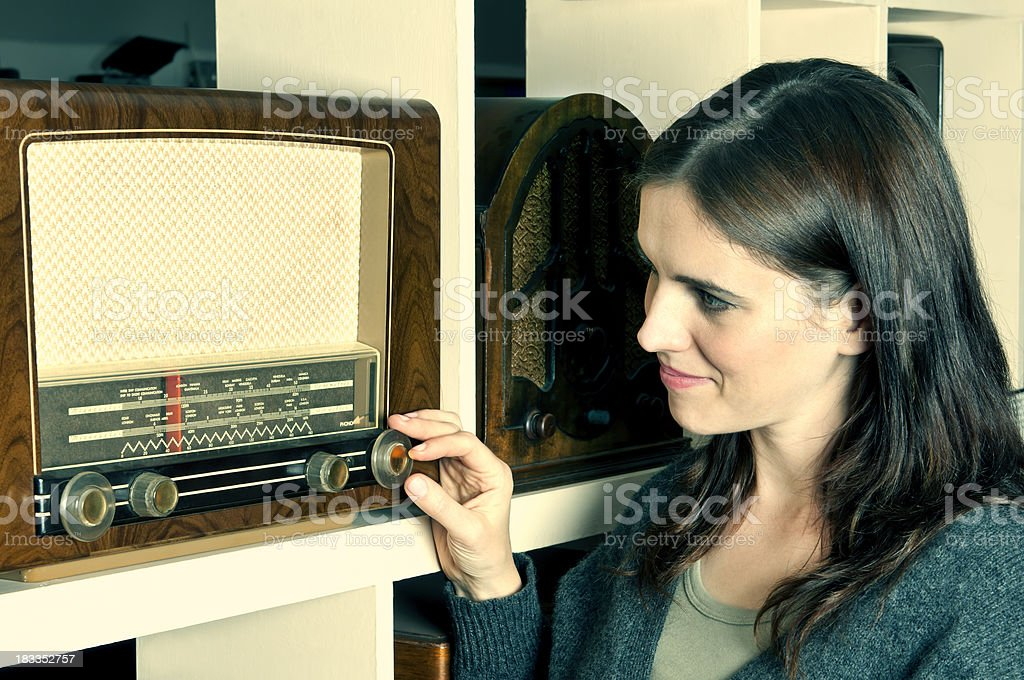 Young woman listening old fashioned radio (retro) stock photo