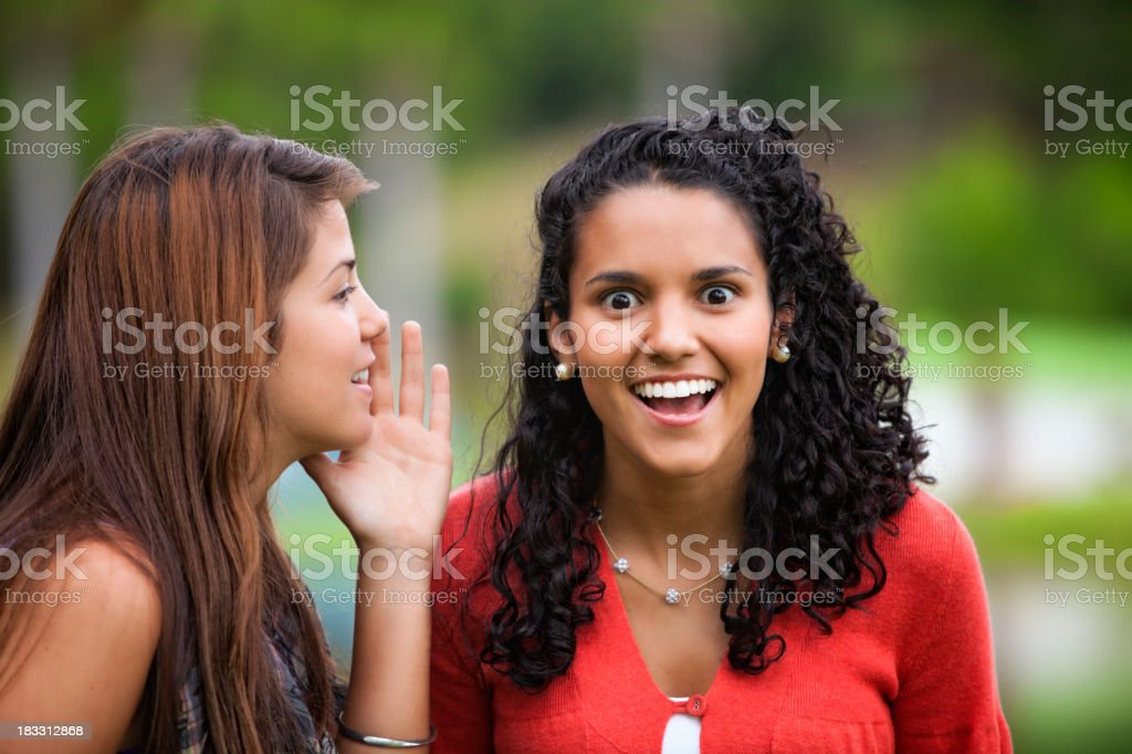 Young woman listening to gossip stock photo