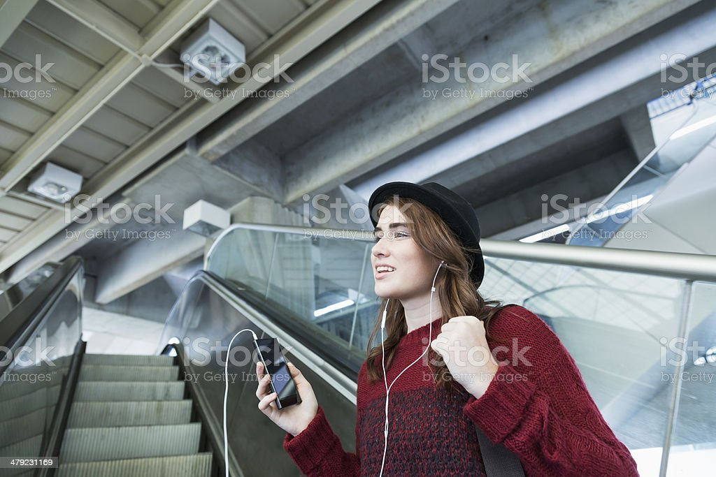 Young woman listening to music royalty-free stock photo