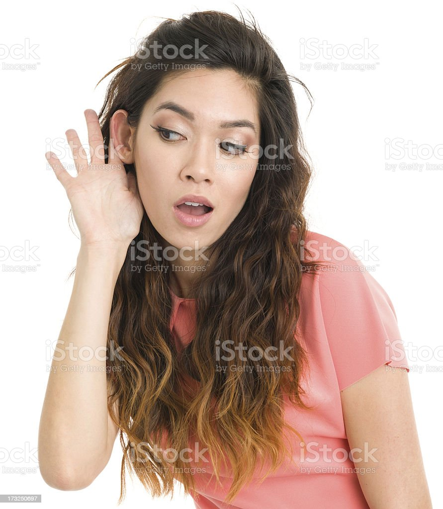 Young Woman Listening With Hand To Ear stock photo