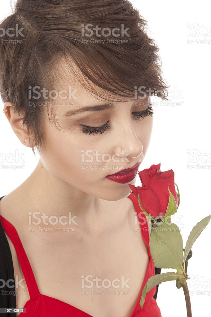 Young woman looking at a rose stock photo