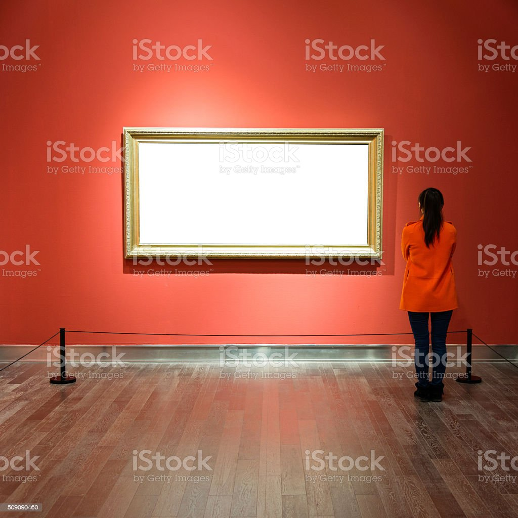 Young woman looking at artwork stock photo