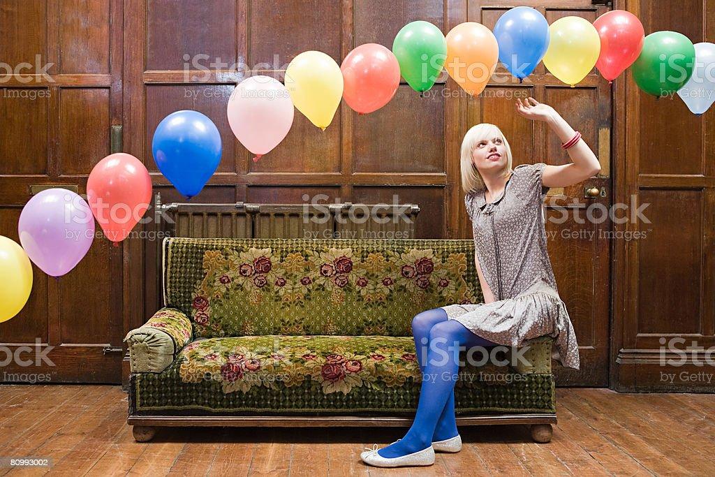 A young woman looking at balloons royalty-free stock photo