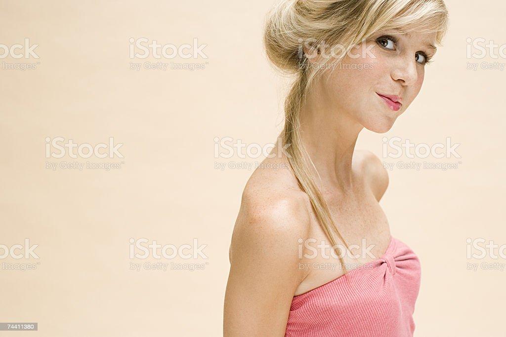 Young woman looking at camera stock photo