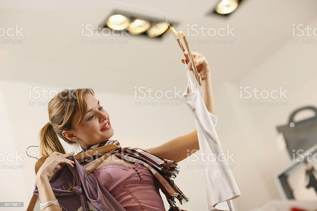 Young woman looking at clothes in shop royalty-free stock photo