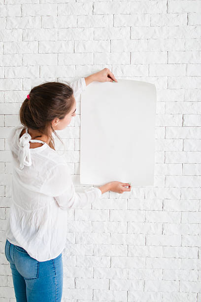 Young woman looking at empty sheet of paper stock photo