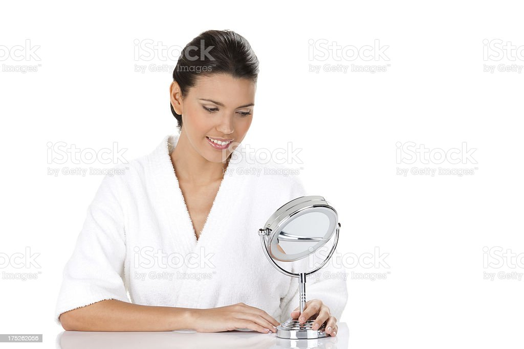 Young Woman Looking at Herself in the Mirror royalty-free stock photo