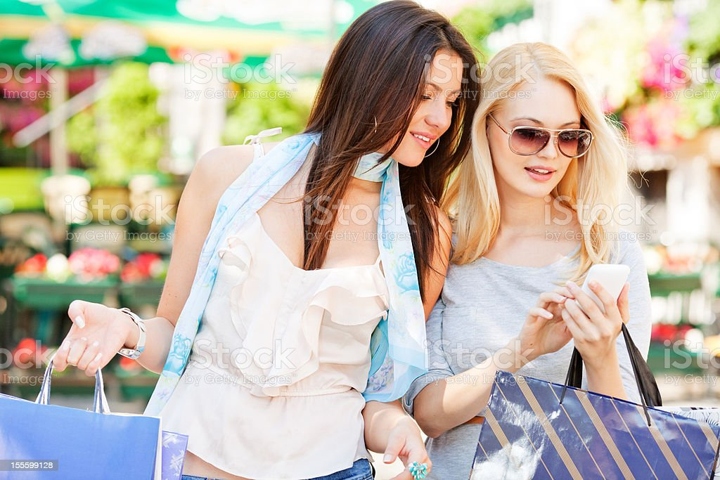 young woman looking at mobile phone royalty-free stock photo