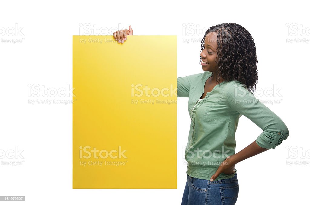 Young woman looking at sign royalty-free stock photo