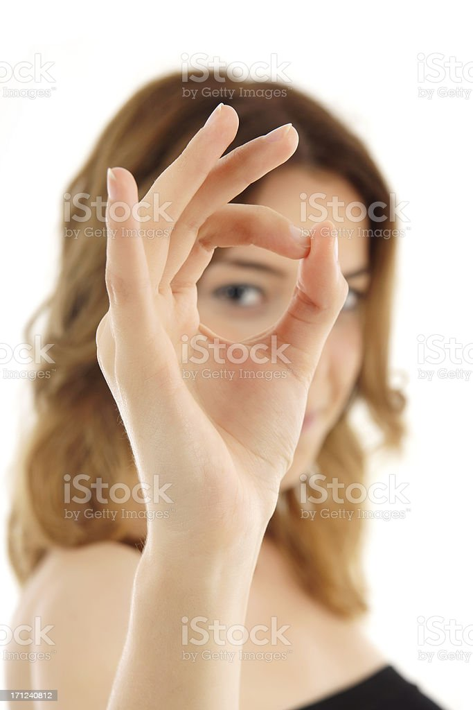 young woman looking at the back of ok sign stock photo