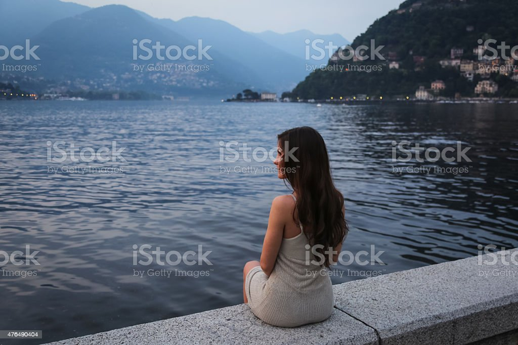 Young woman looking at the beautiful view stock photo