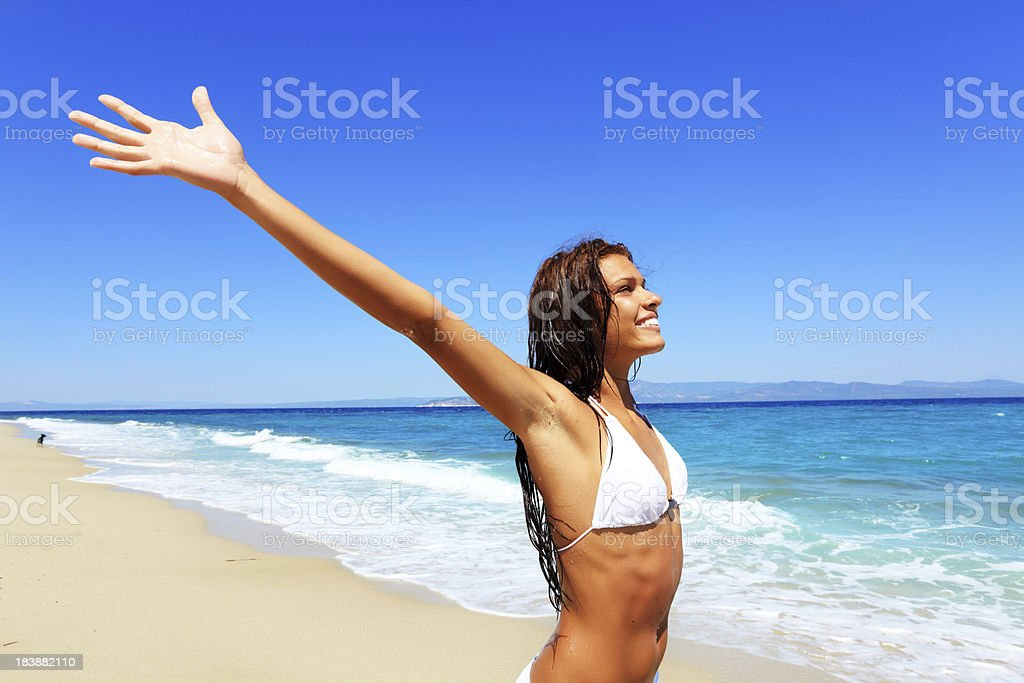Young woman looking at the distance on a beach. royalty-free stock photo