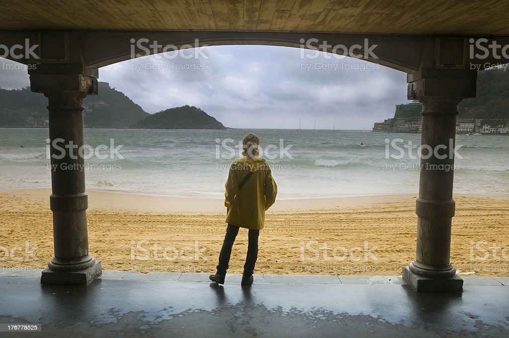 Young woman looking at the sea stock photo
