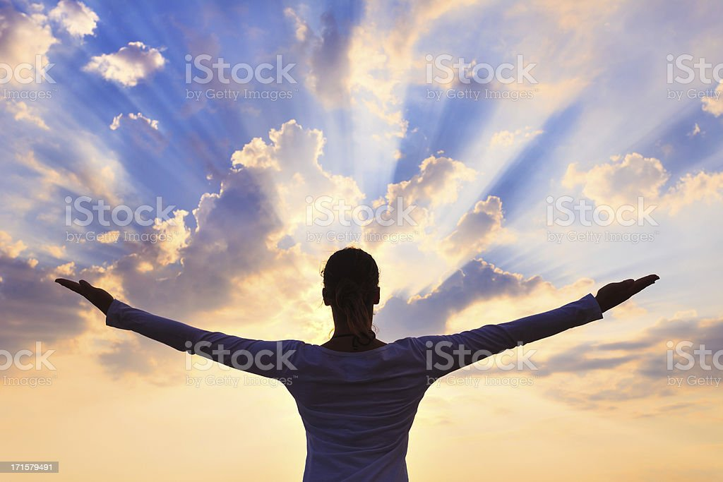 Young Woman Looking At The Sun royalty-free stock photo