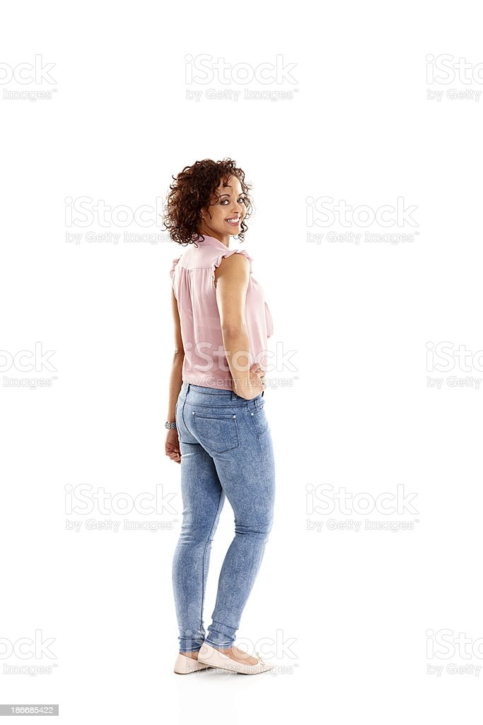 Young woman looking at you smiling stock photo
