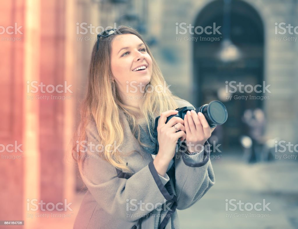 Young woman looking curious and taking pictures royalty-free stock photo