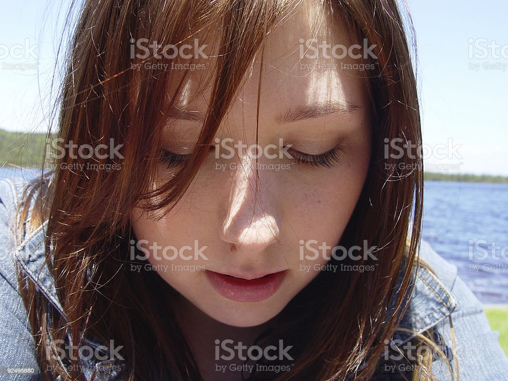 Young Woman Looking Down royalty-free stock photo