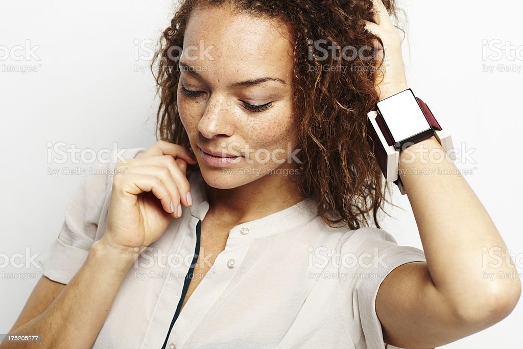 Young woman looking down with hand in hair royalty-free stock photo