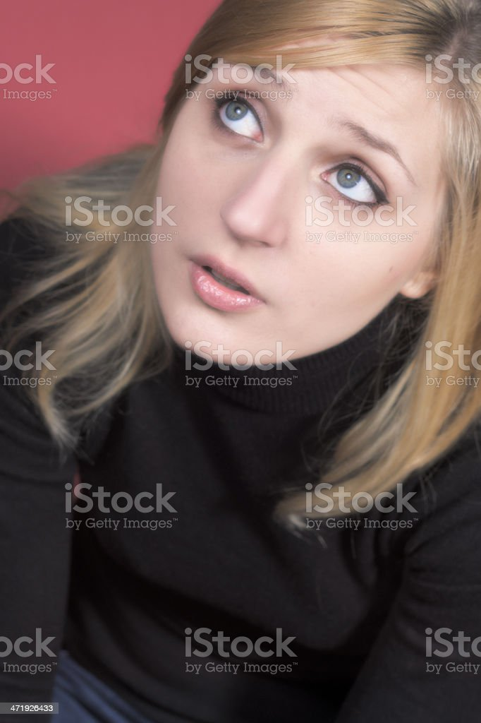 Young woman looking high, photographed from above in casual clot royalty-free stock photo