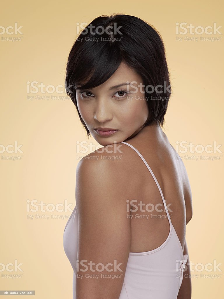 Young woman looking over shoulder, close-up, portrait royalty-free stock photo