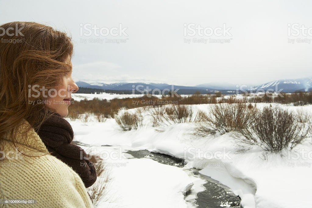 Young woman looking over snowy landscape royalty-free stock photo