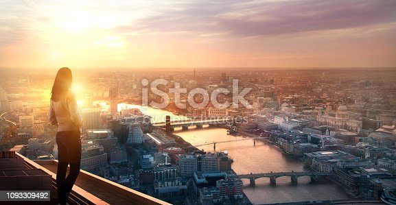 istock Young woman looking over the City of London at sunset. Future, new business opportunity and business success concept. 1093309492