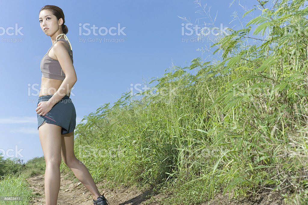 Young woman looking over the shoulder on path 免版稅 stock photo