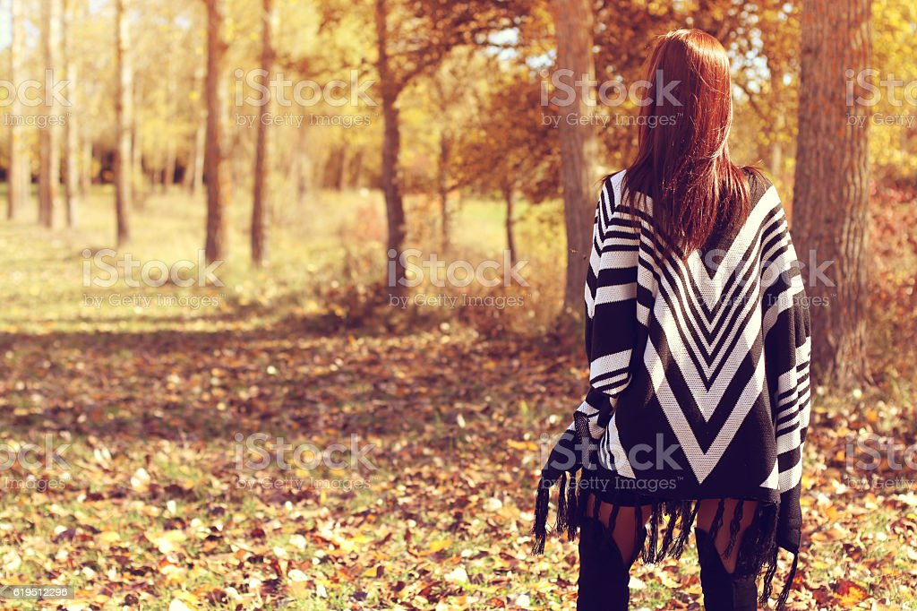 young woman looking the forest in autumn stock photo