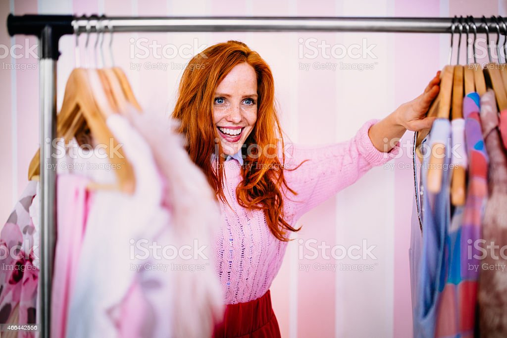 Young Woman Looking Through Clothing stock photo