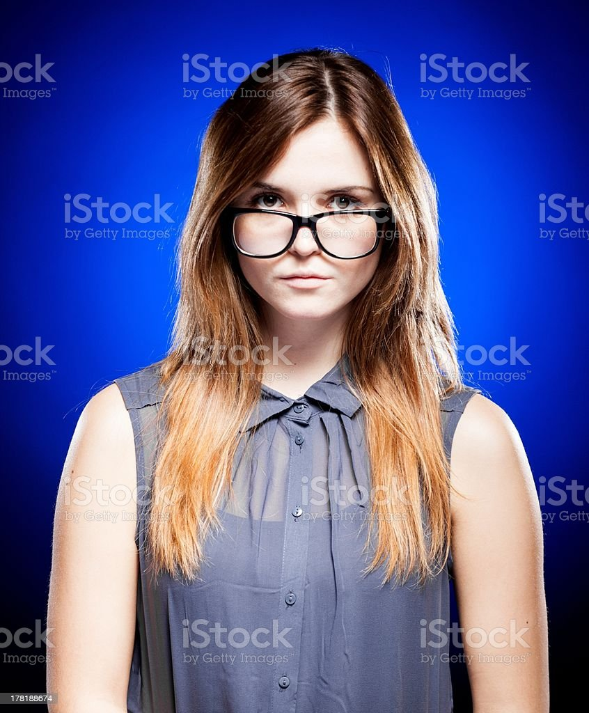 Young woman looking through the nerd glasses stock photo