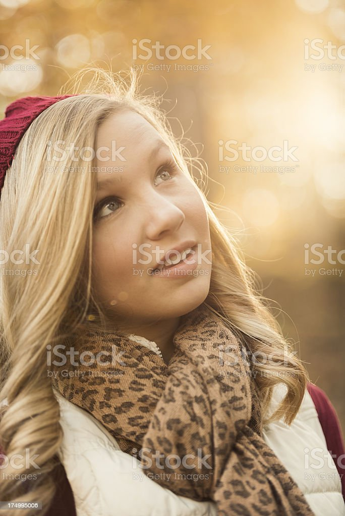 Young Woman Looking Up and to the Side Outdoors royalty-free stock photo