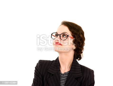 618976144istockphoto Young woman looking up 1159143364