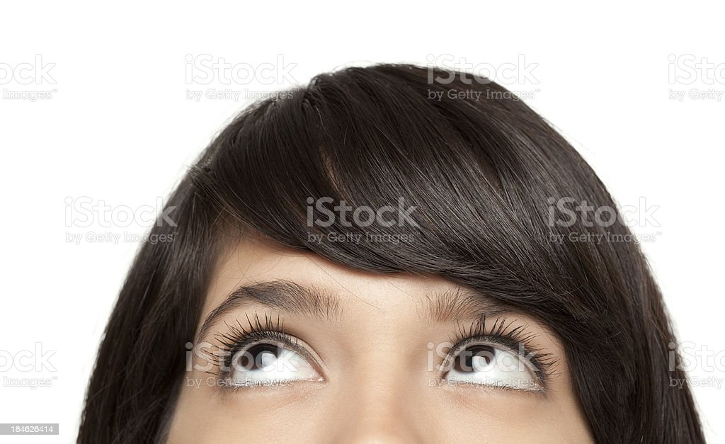 Young woman looking up stock photo