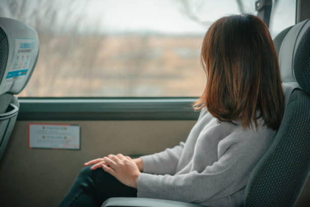 Young woman looking view at window on a bus from airport to the city at Seoul city South Korea