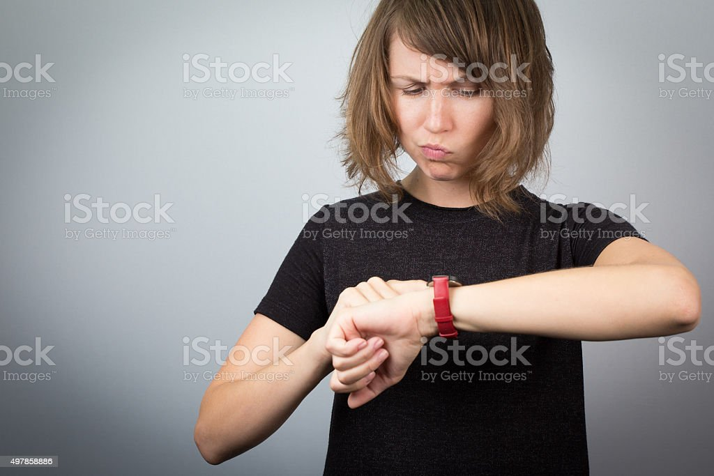 Young woman looking watch time waitnig. stock photo