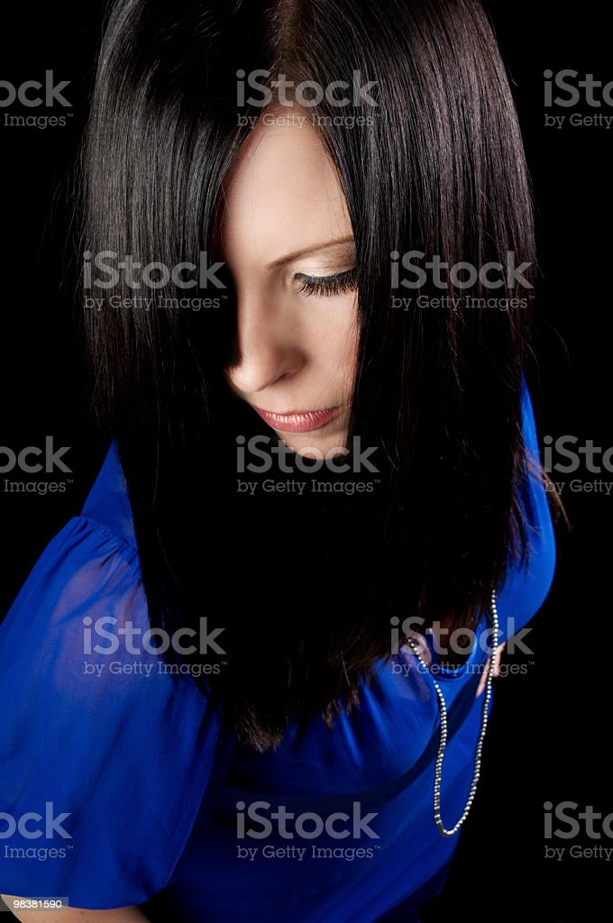 Young woman looks down through curtain of hair royalty-free stock photo
