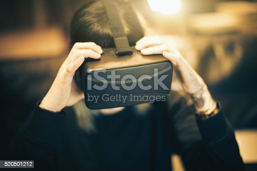 599693172istockphoto Young woman looks fascinated into Virtual Reality Headset 520501212