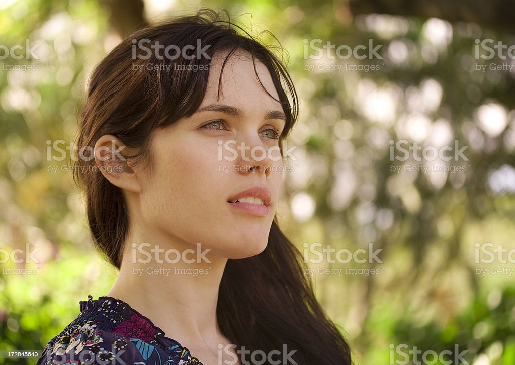 Young woman looks into the future royalty-free stock photo