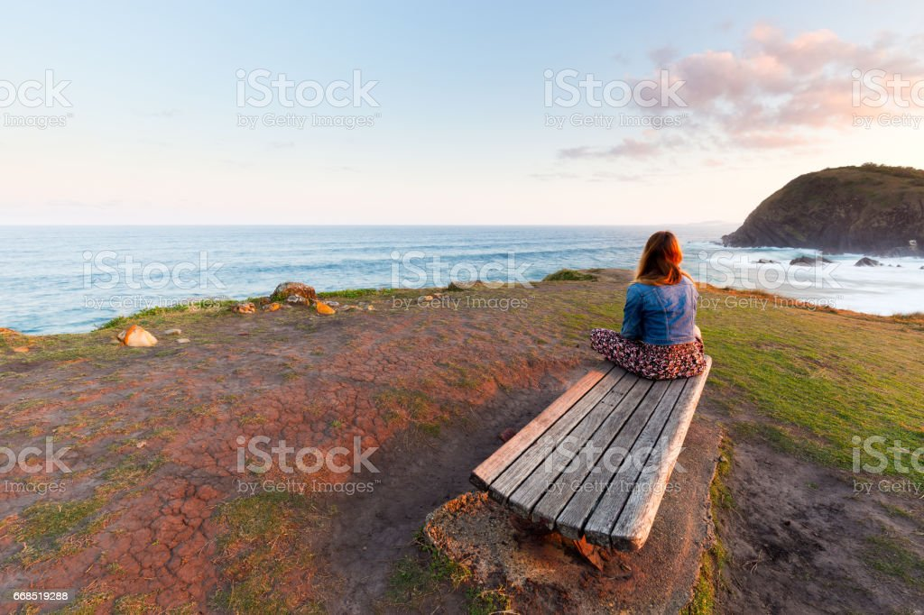 Young Woman Looks Over Morning Ocean View stock photo
