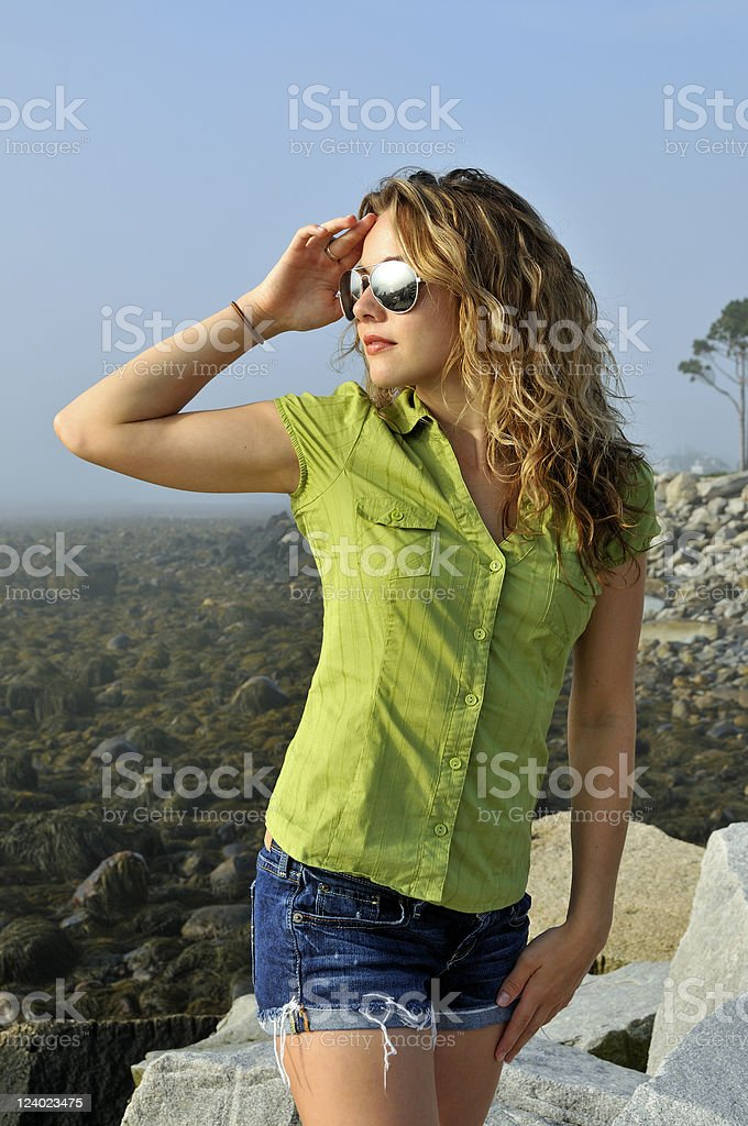 Young Woman Looks to the Sea stock photo