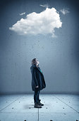 Young woman looks up to a cloud . The concept of cloud storage.