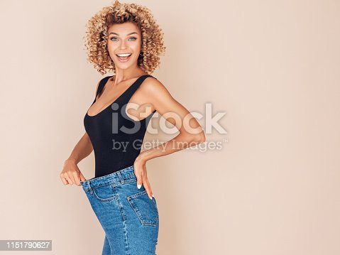 Young woman losing weight