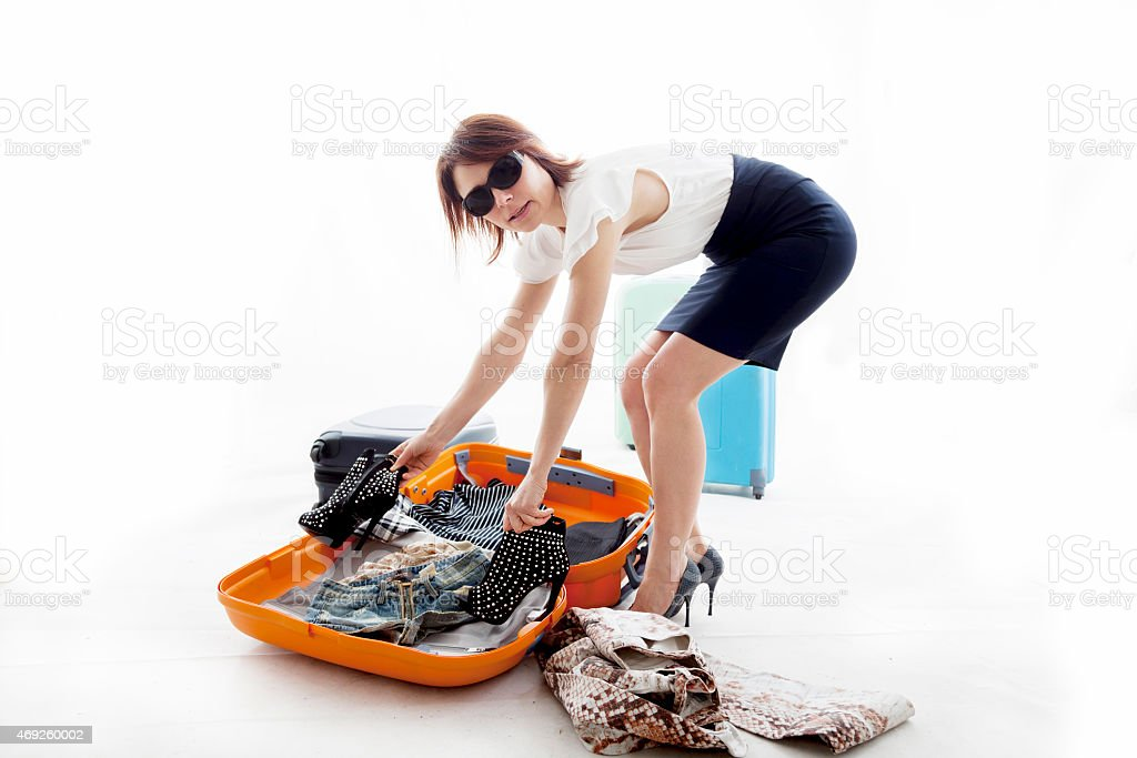 young woman lost the clothes from his suitcase stock photo
