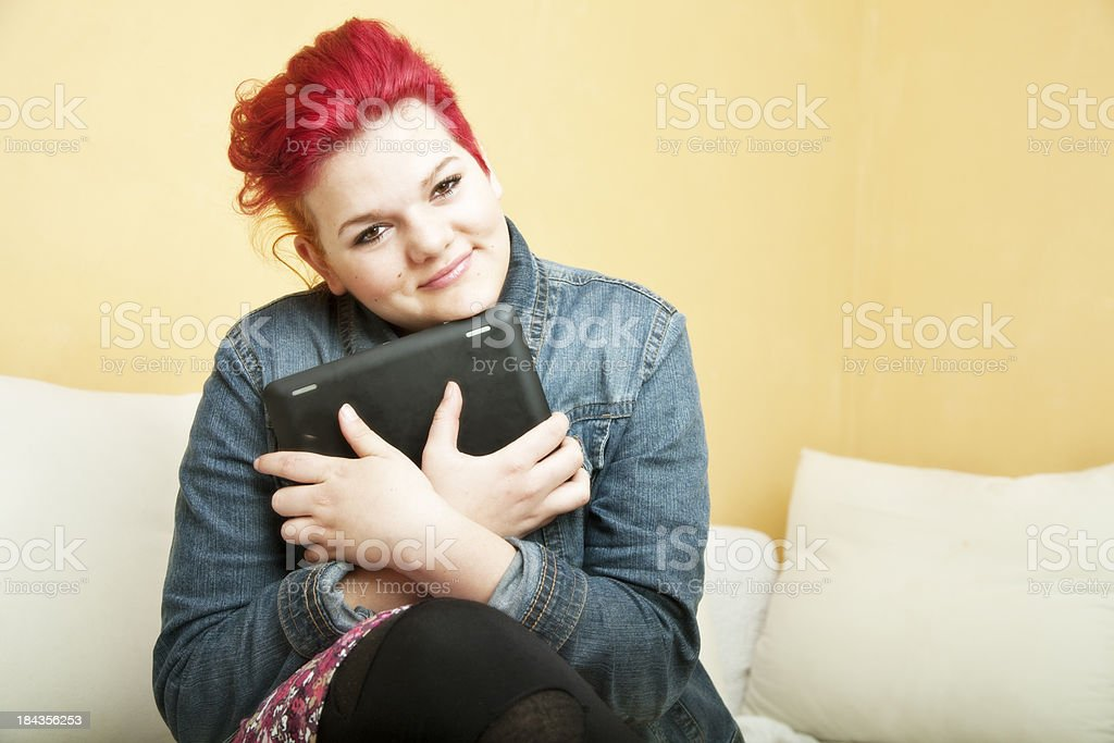 young woman loves her digital tablet royalty-free stock photo