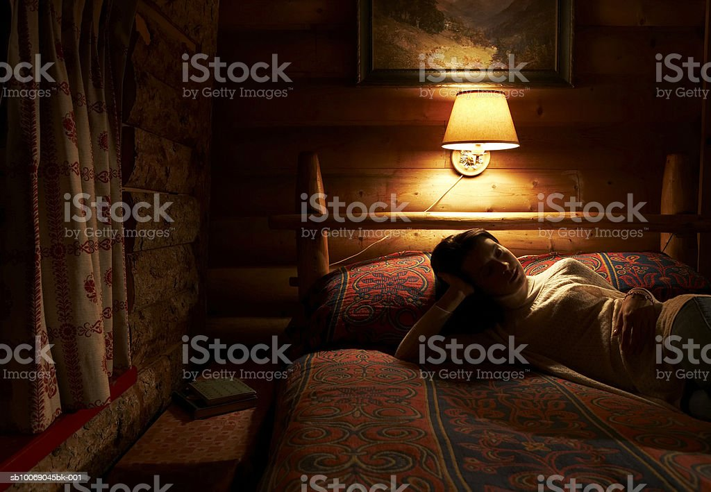 Young woman lying on bed royalty-free stock photo