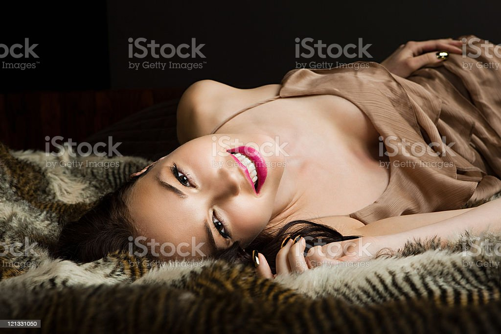Young woman lying on blanket, portrait stock photo