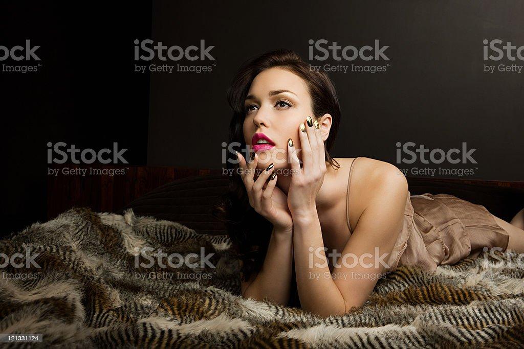 Young woman lying on blanket, portrait stock photo