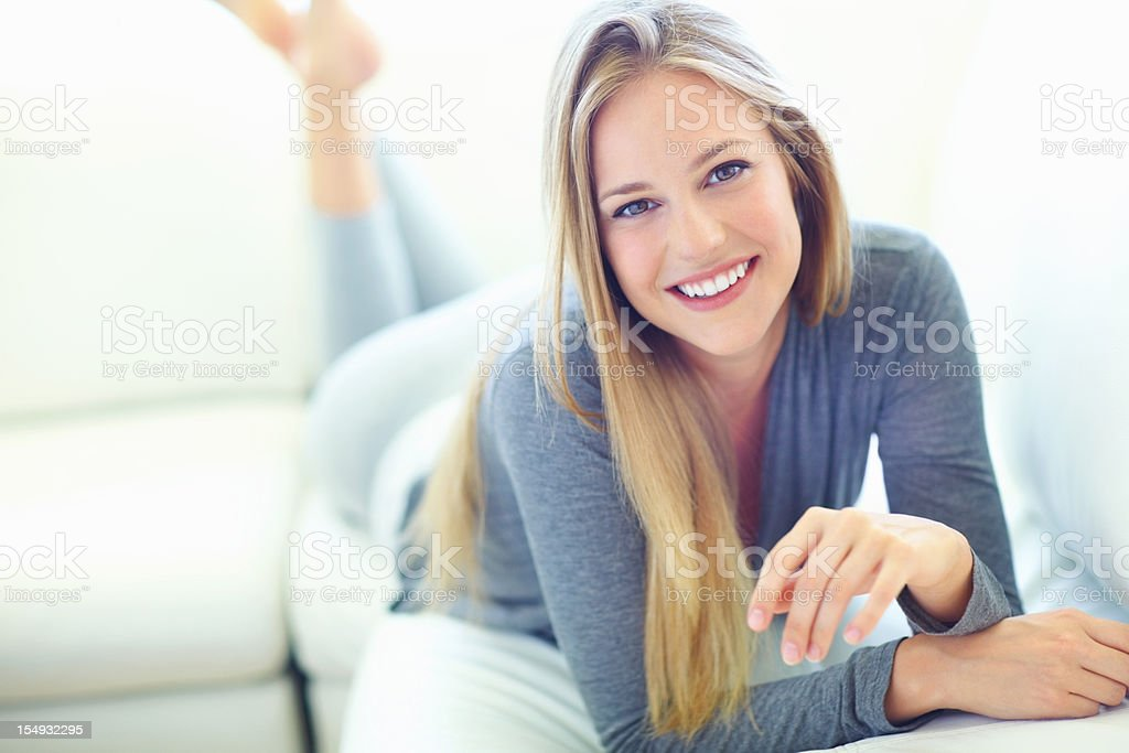 Young woman lying on couch royalty-free stock photo